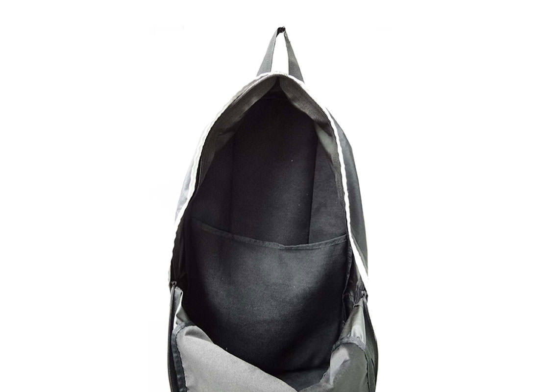 Simple Black Backpack with White Zippers Open