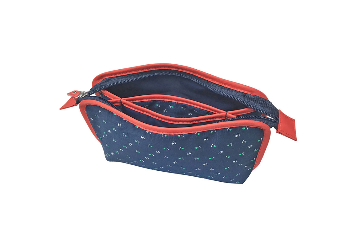 Open Floral cosmetic bag in dark blue with red trimming