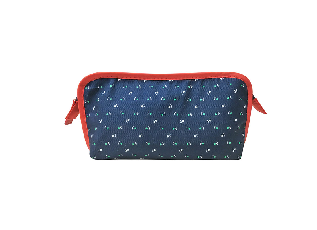 Floral print cosmetic bag in dark blue with red trimming