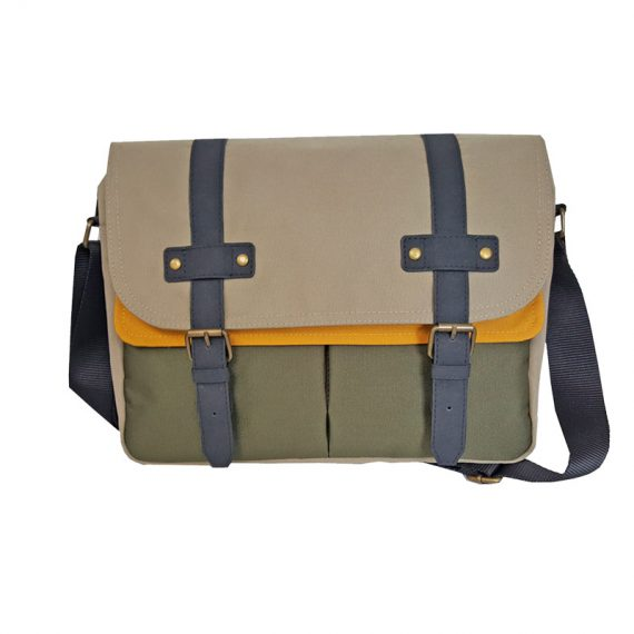 Messenger bag with magnetic button closure