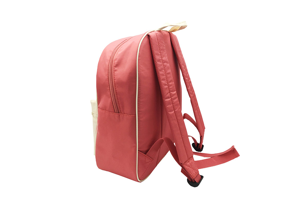 Girl Backpack in pink & beige with a large zipper front pocket side back