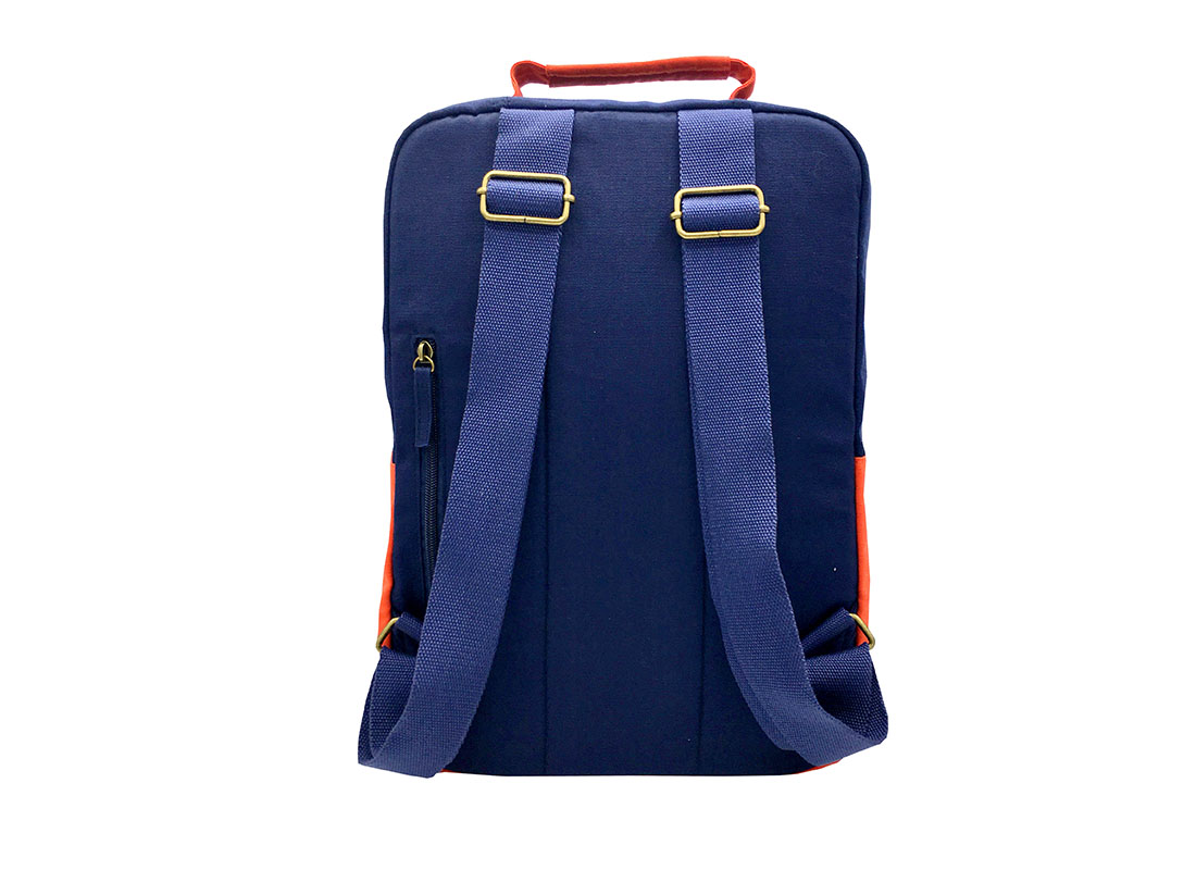 canvas backpack in dark blue with orange flap back