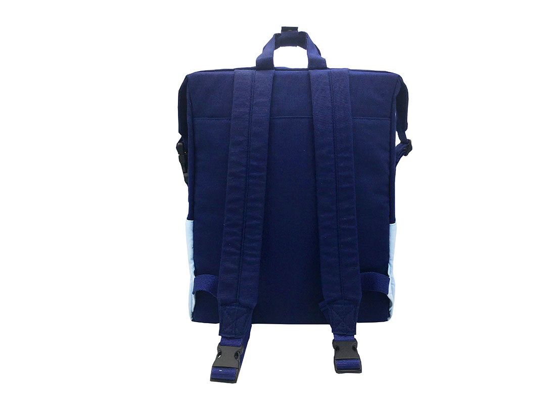 Two way canvas backpack in light & dark blue back