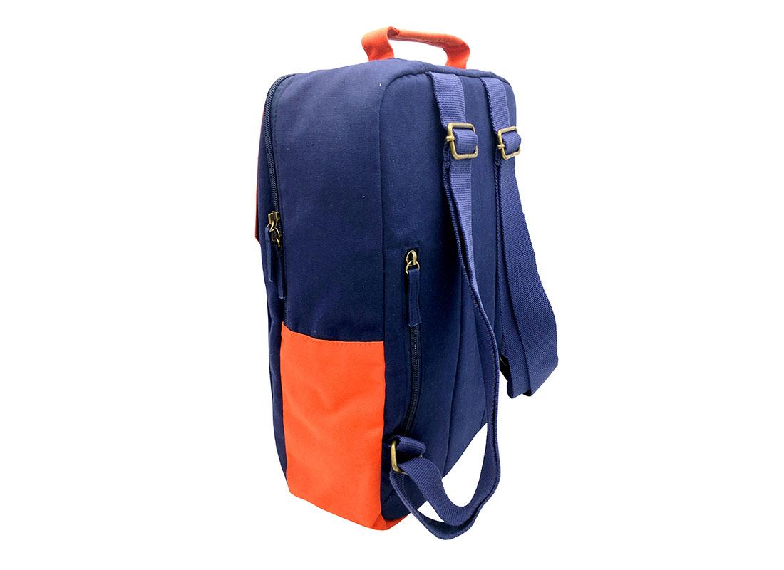 canvas backpack in dark blue with orange flap back side